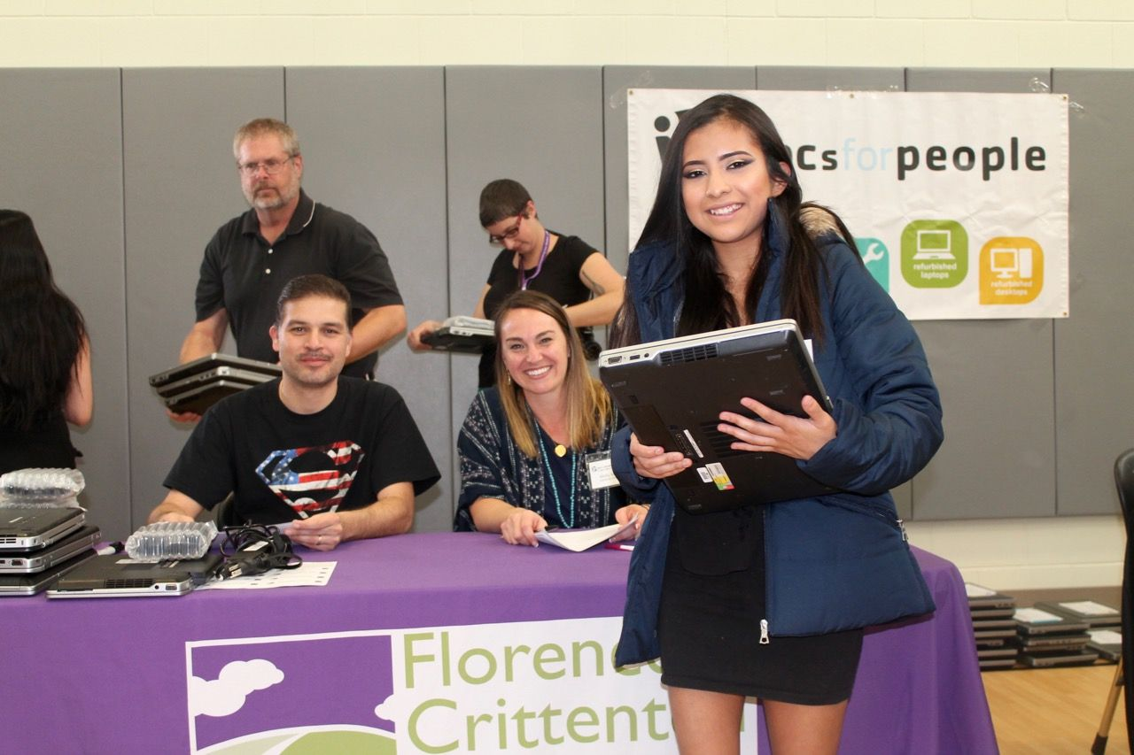 A student receiving a laptop.